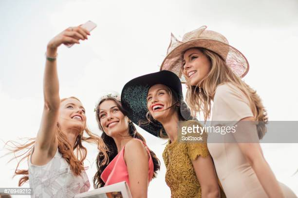 young women taking a selfie - newcastle races stock photos and pictures