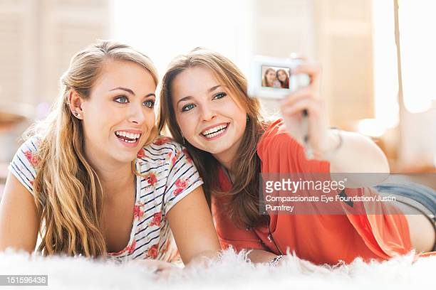 """young women taking photo of themselves - """"compassionate eye"""" stock pictures, royalty-free photos & images"""