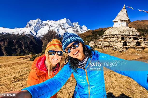 Young women taking selfie in Himalayas, Mount Everest National Park