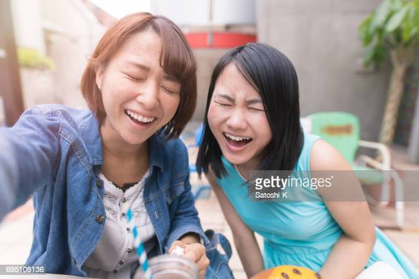 Young women taking selfie picture with full toothy smile