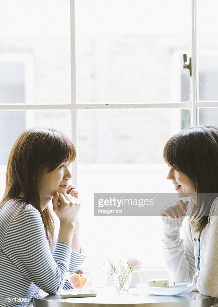 Young women talking at cafe
