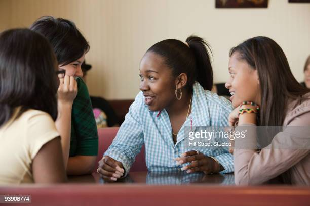 Young women talking in diner