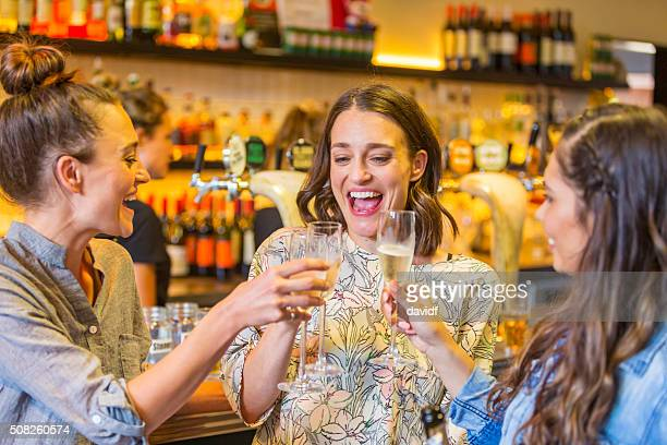 Young Women Toasting With Champagne in a Bar