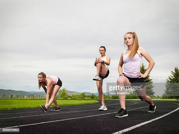 Young women track athletes warming up