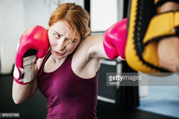 young women training at kickboxing gym - muay thai stock photos and pictures