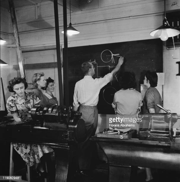 Young women training for war work in the machine shop of the Ministry of Labour training centre at Chelsea Polytechnic later the Chelsea College of...
