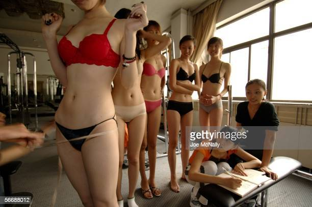 Young women training to be models are measured every week as part of fitness training on September 22 2005 in Beijing China