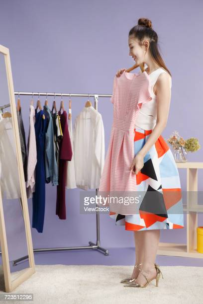Young women try on clothes