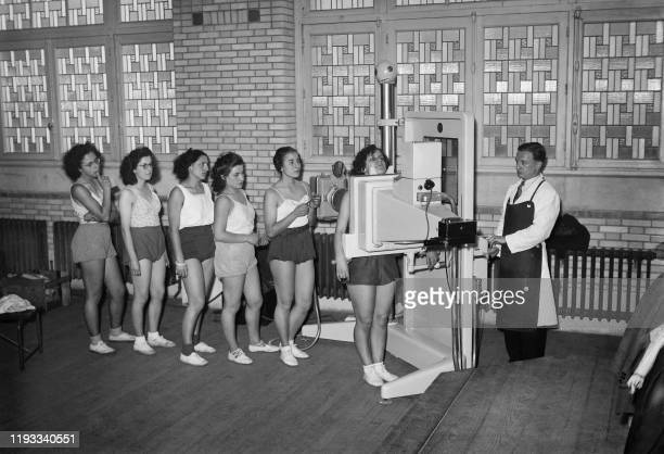 Young women undergo an xray radiography of the lungs during a tuberculosis screening operation at the Marie Curie High school in Paris in November...