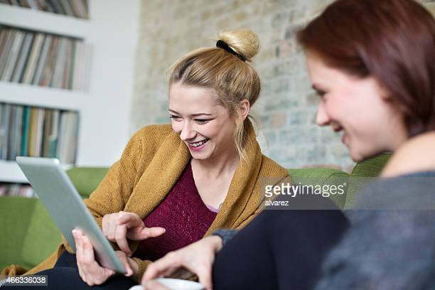 Young women using digital tablet