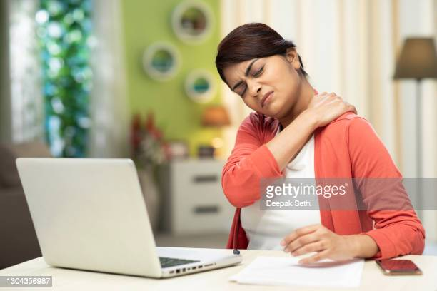 young women using laptop at home, stock photo - pain stock pictures, royalty-free photos & images
