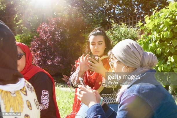 Young women using smartphones