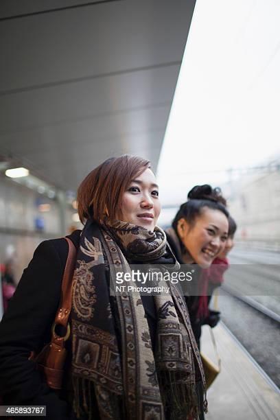 Young women waiting for train
