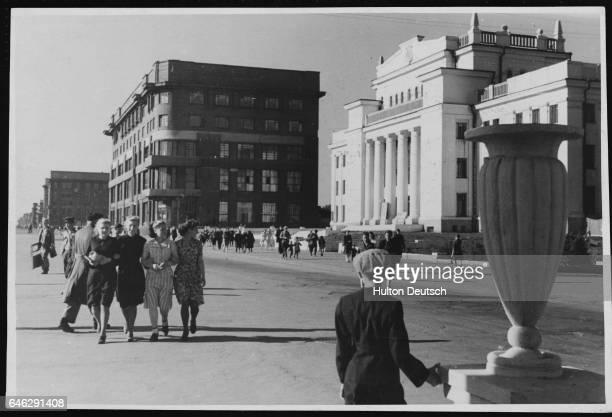 Young women walk arminarm along Novosibirsk's main thoroughfare which runs outside the Children's Theater