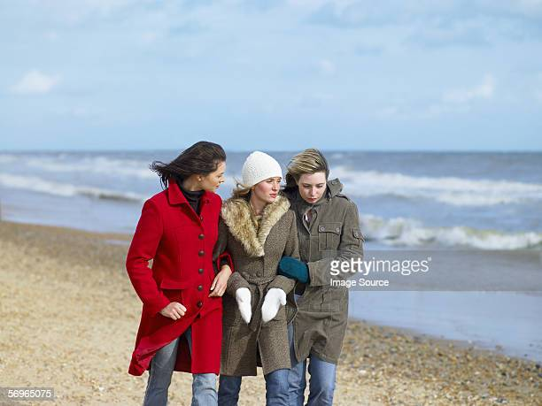 Young women walking on the beach
