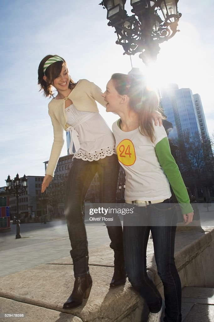 Young women walking together : Photo
