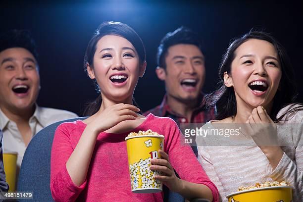 Young women watching movie in cinema