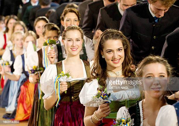 Young women wear the traditional dress dirndl as they prepare to dance on January 28 2013 at the Hofburg Palace in Vienna during the socalled...