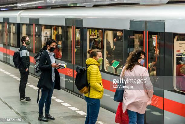 Young women wearing facial masks are seen waiting for their train on the first day of the end of state of emergency. State of emergency due to the...