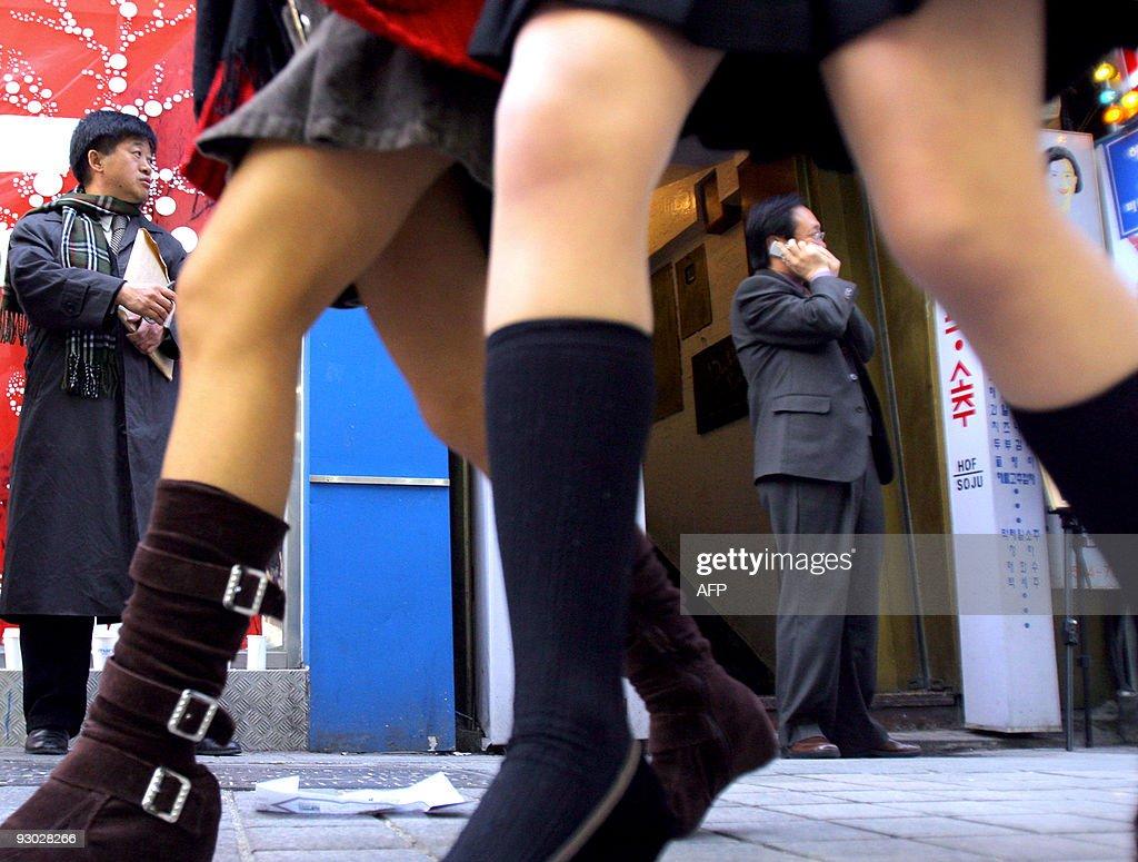 Young women wearing mini skirts stroll a : News Photo