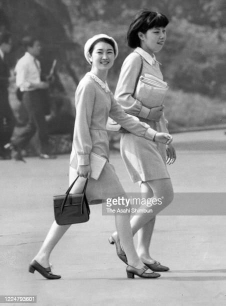 Young women wearing miniskirts walk at Hibiya Park on May 10 1969 in Tokyo Japan