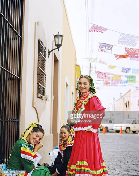 Young women wearing traditional dress at fiesta, portrait