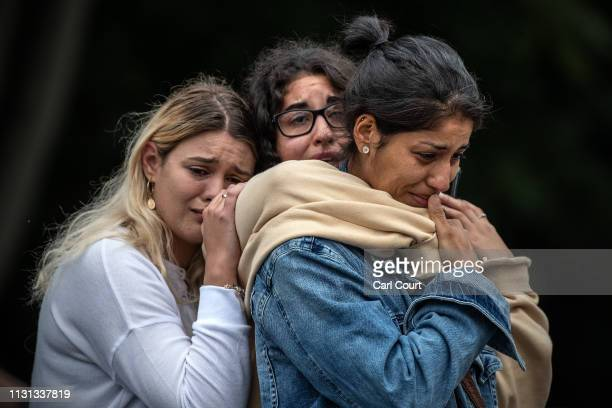 Young women weep as they hold each other for comfort during a students vigil near Al Noor mosque on March 18 2019 in Christchurch New Zealand 50...