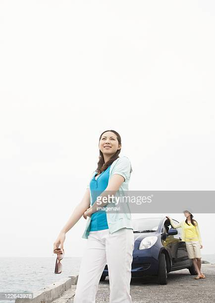 Young women with a car