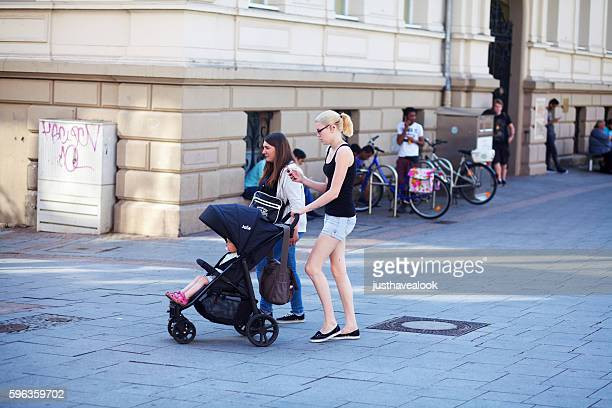 Young women with baby buggy