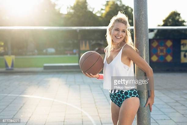 young women with basketball