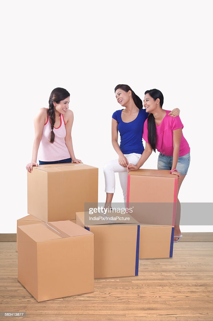 Young women with cartons : Stock Photo