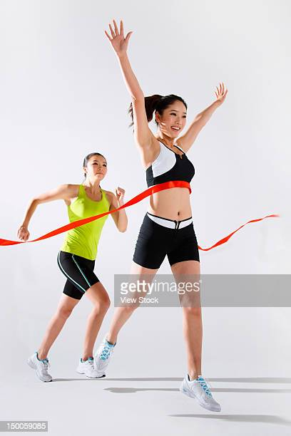 Young women with finish line