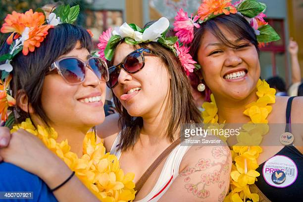 CONTENT] Young women with flower headdresses at the annual Gay Pride festival A large street party around city center takes place after the Gay Pride...