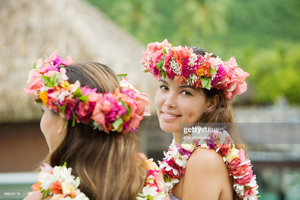 Young women with flowers in hair in moorea : Stock Photo