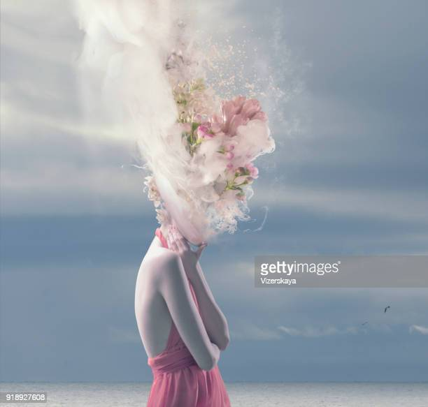 young women with melted head - surreal stock pictures, royalty-free photos & images