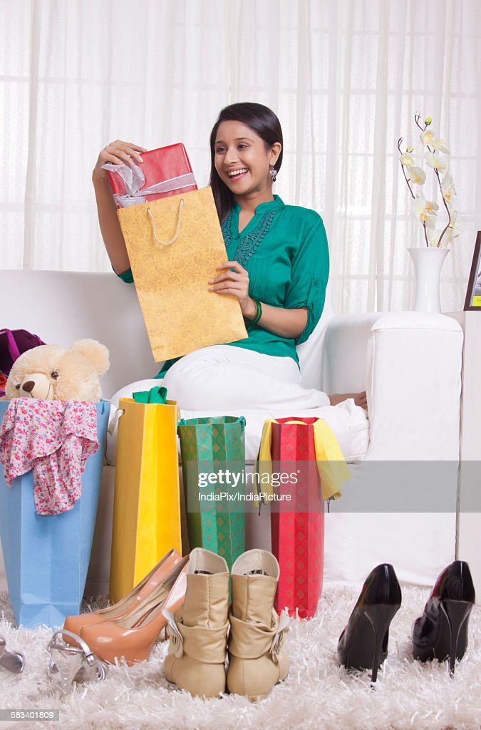 Young WOMEN with shopped goods : Stock Photo