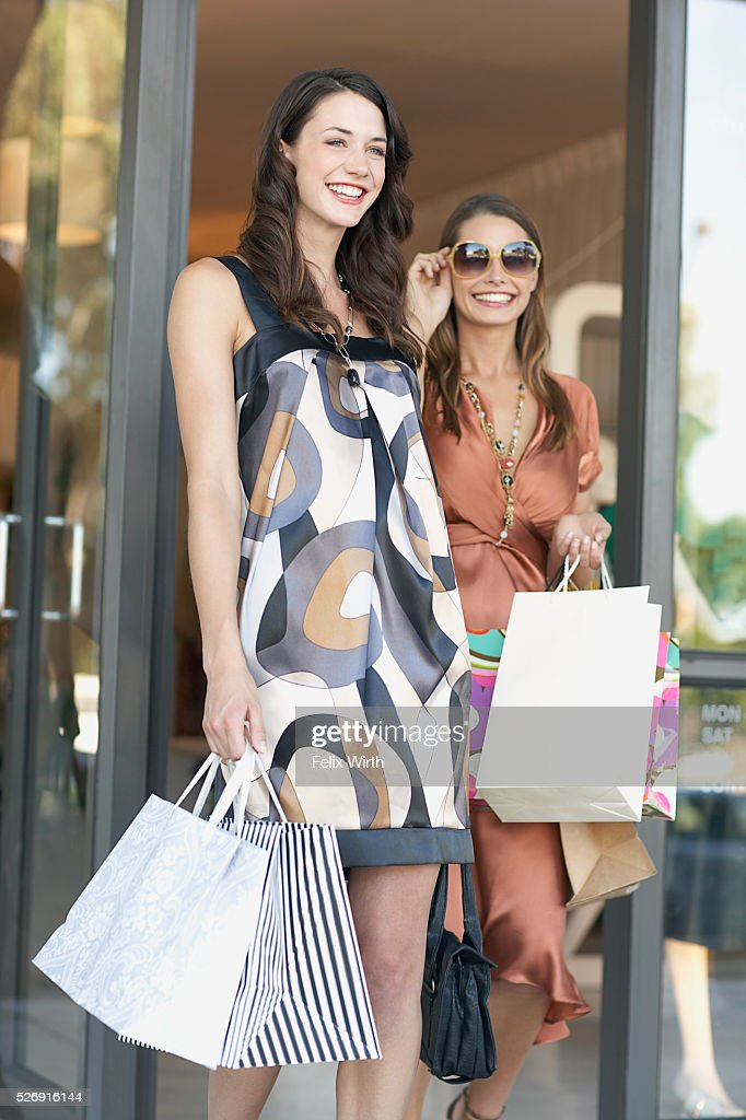Young women with shopping bags : Stock Photo