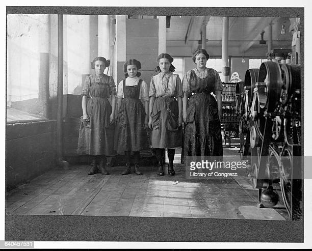 Young women work at the machine loom in the Cornell textile mill in Fall River Massachusetts 1912 | Location Cornell Mill Fall River Massachusetts USA