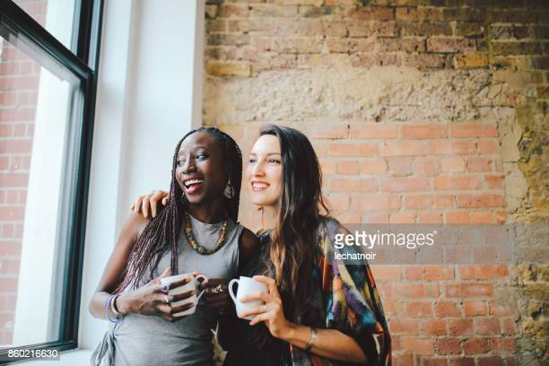 Young women working having a coffee together