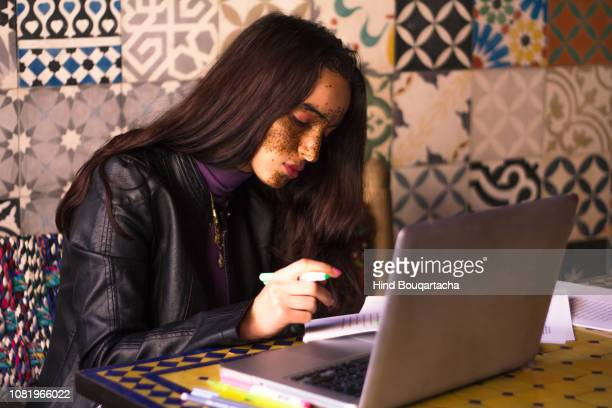 young women working in front of her computer - north africa stock pictures, royalty-free photos & images