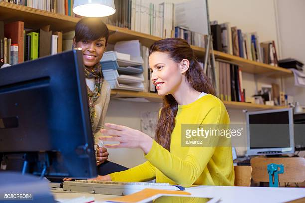 Young women working together on a computer