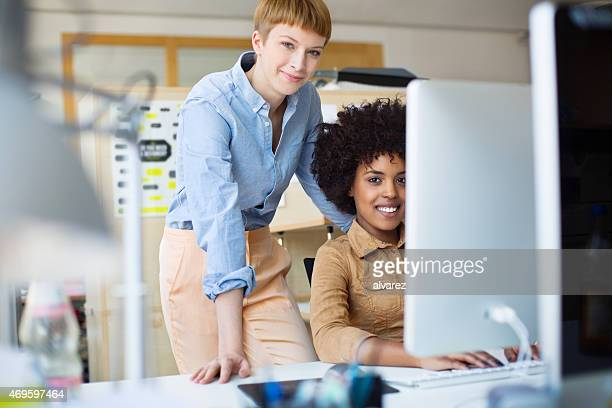 Young women working together