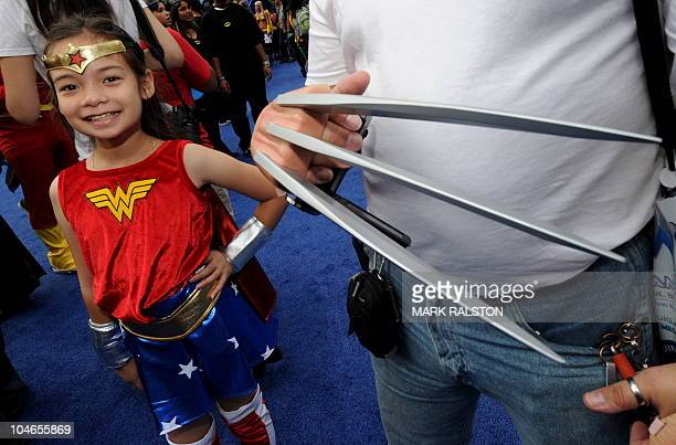 A young Wonder Woman joins over 1580 costumed superheroes during the successful attempt to break the Guinness World Record for the largest gathering...