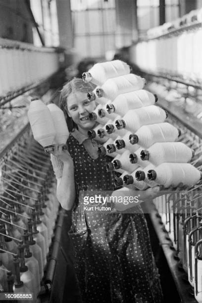 A young worker at Eckersley's cotton mill in Wigan Greater Manchester UK 1939 Original Publication Picture Post 228 Wigan pub 11th November 1939