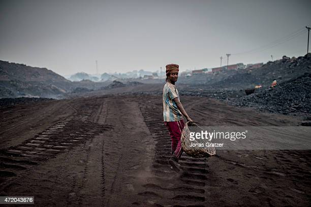 A young worker in the coal mines of Jharia Jharia in India's eastern Jharkand state is literally in flames This is due to the open cast coal mining...