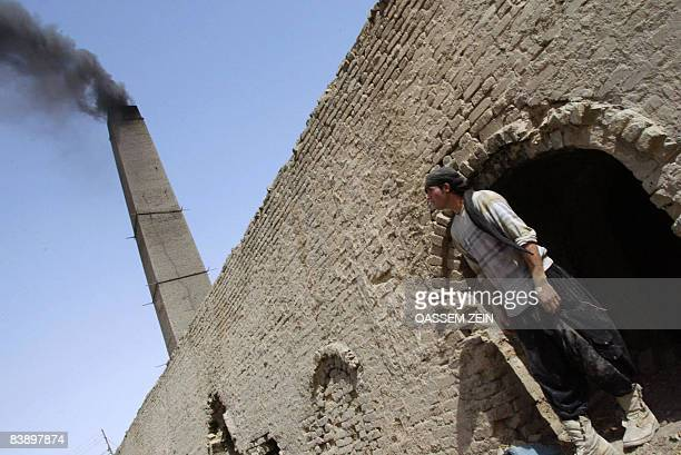 A young worker is seen at a brick factory in the holy Shiite Muslim southern city of Najaf some 160 kms from Baghdad on May 26 2008 The bricks are...