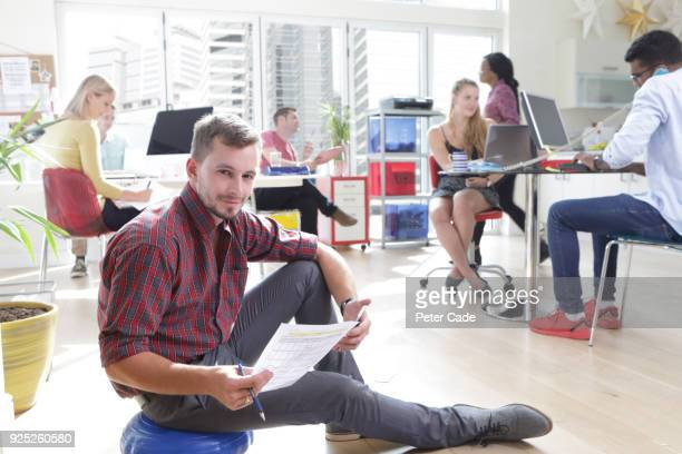 young worker sat on floor in casual office