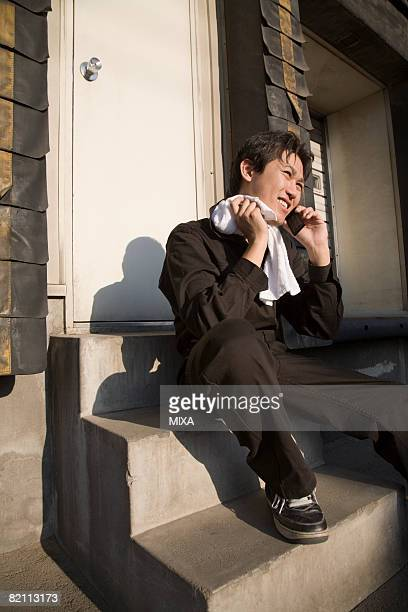 Young worker talking over mobile phone