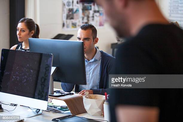Young workers in creative office space.