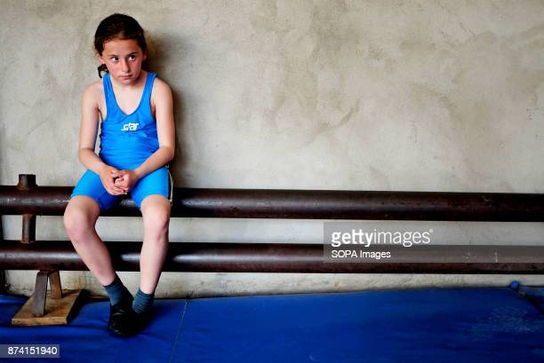 A young wrestler pictured at the local gym When two wrestle together their sweat mix and they become brothers forever Nugzar Skhireli has a lot of...